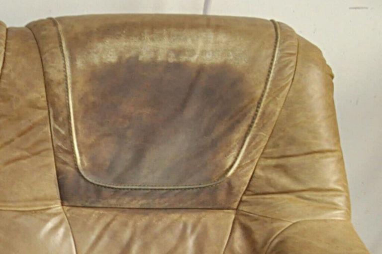 zatłuszczone oparcie na kanapie skórzanej